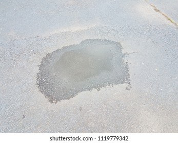 water puddle on black asphalt