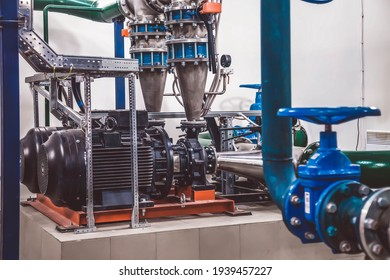 Water pump station and pipeline with tanks in an industrial room to supply high pressure water for firefight tasks. Sprinkler pipes and control system to provide drink water to people in building
