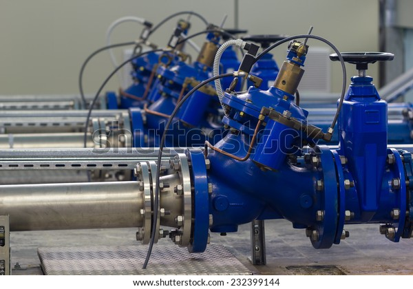Water pumping station with booster pump control valves.