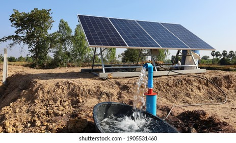 Water pumps and solar panels. Groundwater is pumped with a submersible pump from clean energy or solar energy converted to electric energy on an agricultural farm with a copy area. Selective focus