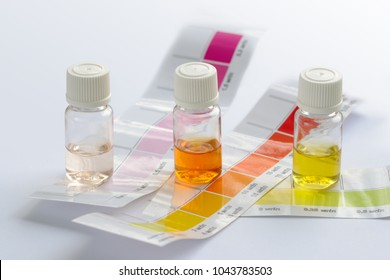 Water quality testing. Three vials with different colored liquids and color scales to determine water characteristics at home