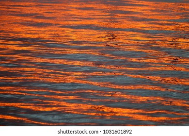 water refelection of sunset with yellow golden colour.