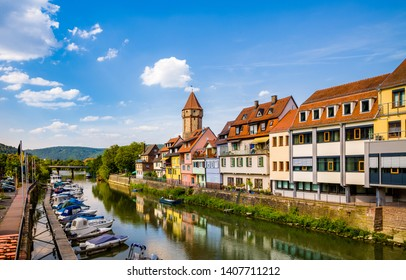 Water reflection of colorful buildings in Wertheim am Main, Germany.
