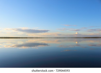 water reflection at lake inari, finland, europe