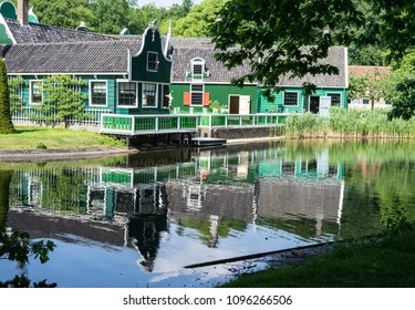 Water reflection of  a traditional dutch building at Arnhem open  air and national heritage  museum, in Arnhem, Netherlands