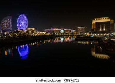 Water reflection of wonderful color at night time ,cityscape view at Yokohama japan