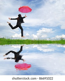 Water reflection,Red umbrella woman jump to sky
