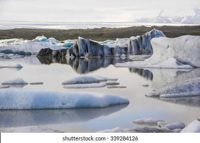 Water reflections in Iceberg in Jokulsarlon glacier lake in Iceland. The icebergs originated from the Vatnajokull float. This location was used for various action movies.