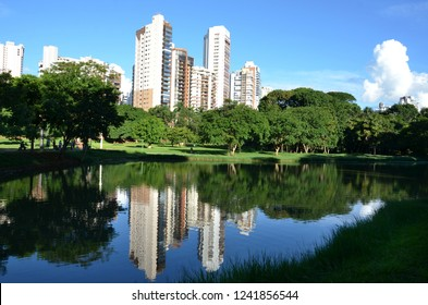 Water reflects residential buildings close to the park in Goiania, Goias, Brazil