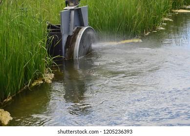 water regulator on irrigation ditch