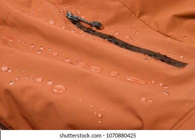 Water repellent coating durable repellency fabric outdoor shell jacket with water drops. Waterproof membrane with droplets.
