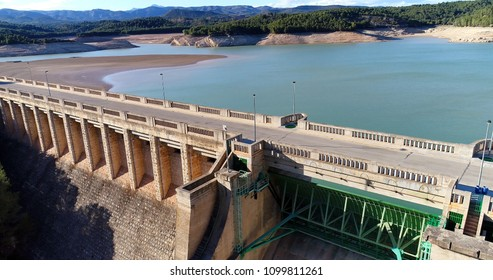 Water reservoir and hydroelectric power generating station in Spain. Horizontal composition.