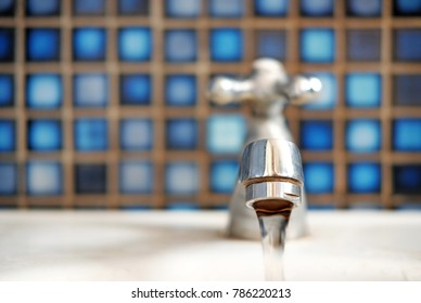 Water running from a faucet.