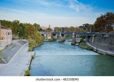 Water runs to the modern bridge in old Rome