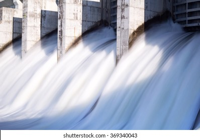 Water rushing out of open gates of a hydro electric power station in long exposure