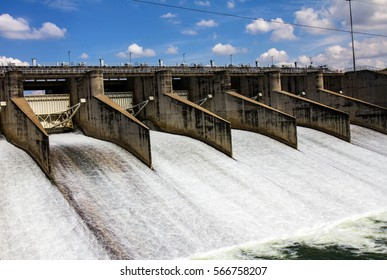 Water rushing through gates at a dam in Thailand.