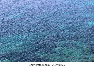 Water sea ocean surface texture calm clean clear summer nobody abstract turquoise blue crystal background wallpaper detail fragment