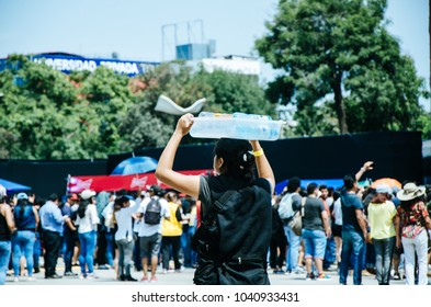 Water seller with a box on his head that contains water bottles