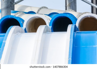Water slides of white and blue pipes in aquapark