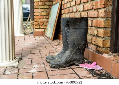 Water soaked rain boots next to a flooded home after Hurricane Harvey
