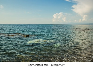 water soft blue surface with small waves near shoreline nature background view