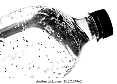 Water is the source of life. Water in a bottle on a white background. Black and white photo.