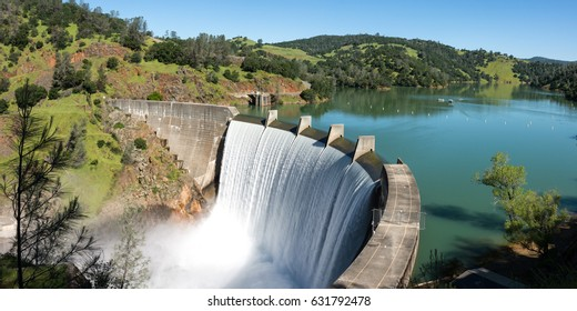 Water spills over the top of Englebright Dam on the Yuba River. A larger than normal snow pack in the Sierra Nevada Mountains has increased runoff into lakes and rivers in California.