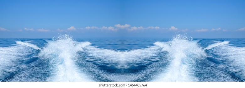 Water splash behind the ship or wake of speed boat in the ocean with beautiful blue sky and white clouds use for holiday and transportation background