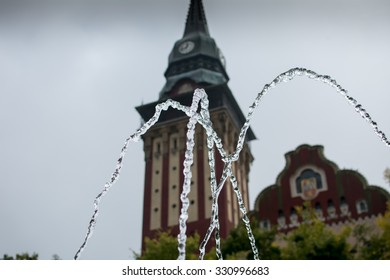 Water splash in city fountain. In the background is Town hall of Subotica