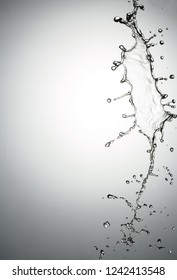 water splash with a lot of drops on a gray background.