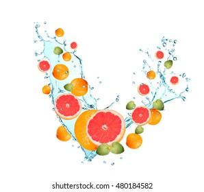 Water splash with fruits isolated on white backgroud. Fresh grapefruits