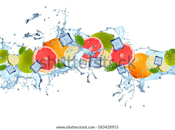 Water splash with mix citrus isolated on white background. Abstract object with fresh fruits.
