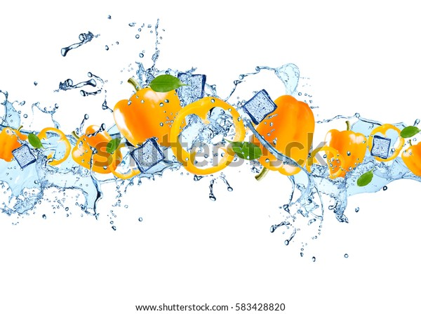 Water splash with peppers isolated on white background. Abstract object with fresh vegetable.