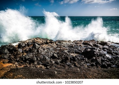 Water splashes at a rocky beach