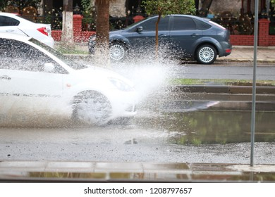 Water splashing drivers while driving in rainy weather