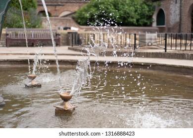 Water is splashing in the fountain.