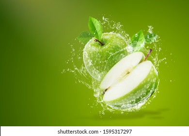 Water splashing on Fresh green apple on Green background.