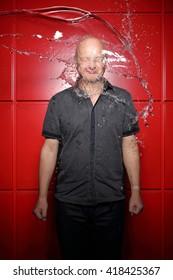 water splashing on a man's face