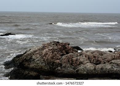water splashing on rocks in beach