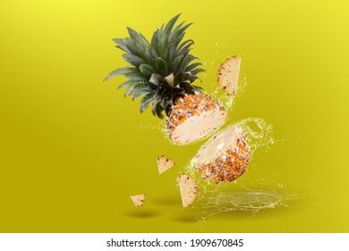 Water Splashing on Split Pineapple Fruit isolated over yellow background.