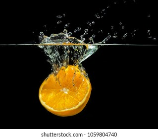 water splashing orange fruit