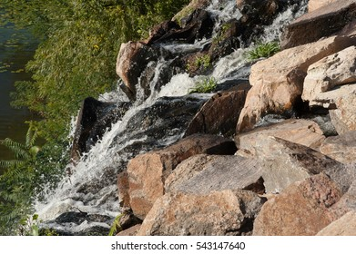 water splashing over the rocks in the park