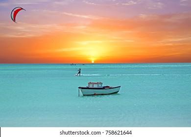 Water sport at Palm Beach on Aruba island at sunset