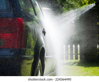 Water spray cleaning car body