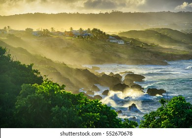 Water spray hitting the land after strong waves splash on the rock, sunset at Ragged point in Eastern-Barbados
