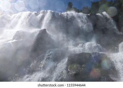 Water spray on the camera lens from standing directly under the Ars waterfall on the GR10 trail in the Pyrenees, France