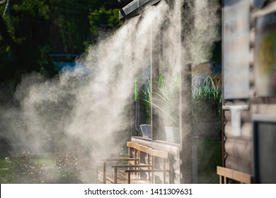water spray system for cooling in a public cafe at the boiling hot summer day