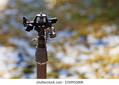 a water spreader at the church in close-up with blurry background