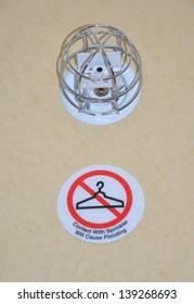Water sprinkler caution sign
