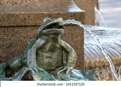 water spying frog as part of the famous  stork fountain in Copenhagen, Denmark